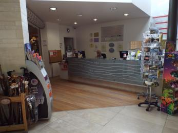 A photograph of the Reception desk at Creswell Crags Museum and Heritage Centre