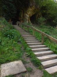 A photograph of the steps leading up to the entrance of Church Hole Cave at Creswell Crags Museum and Heritage Centre.