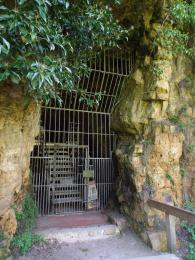 A photograph of the entrance grill and hinged door at Church Hole Cave at Creswell Crags Museum and Heritage Centre.