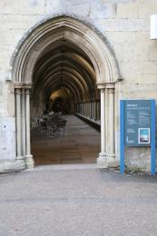 The main entrance leading into the Cloisters.  The door is held open on the right hand side