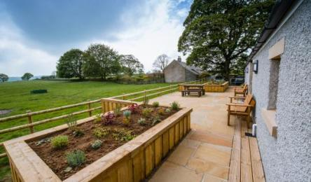 Raised beds, patio and adjoining fields