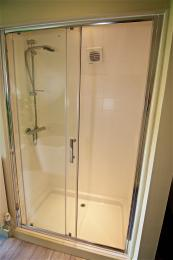 Shower in the first floor bedroom has a raised tray to step into