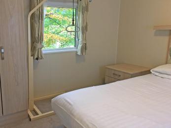 2 bedroomed accessible caravan double bedroom with portable pulley helper