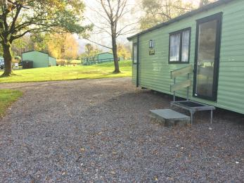Superior 2 bedroomed Sierra Caravan showing exterior step access and parking  area