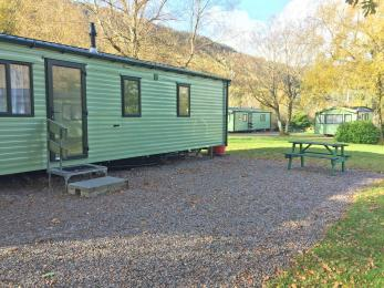 Superior 2 bedroomed Sierra Caravan showing exterior step access and outside seating area