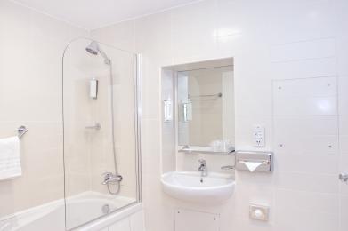 larher family bathroom with shower over bath