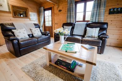 Looking from kitchen across open plan living room to main entrance door