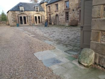paved path and cobbled area at entrance to Visitor Centre
