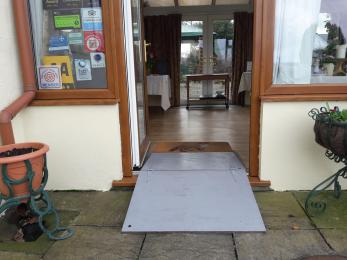 Entrance with portable ramp