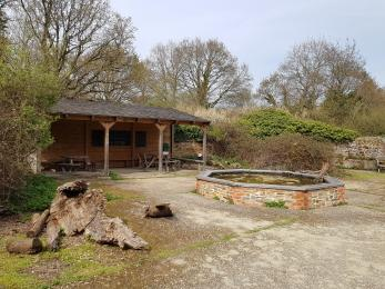 Picnic tables in Fattengates courtyard shelter