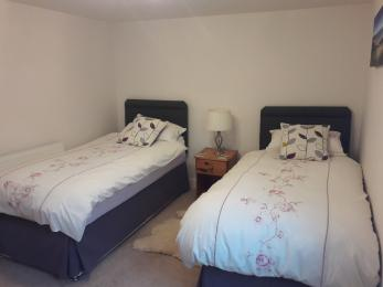 Bedroom 1 configured with two single beds
