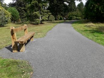 Upgraded (2018) stone path inside the National Pinetum. The photo also shows one of a number of timber benches.