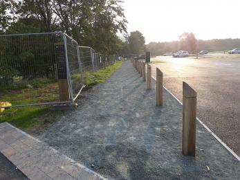 Tar spray and chip path along car park
