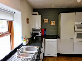 The sink, dishwasher and fridge/freezer