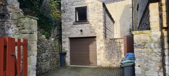 Garage entrance and car parking