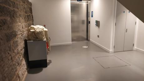 The space between the lift and the corridor with the toilets.