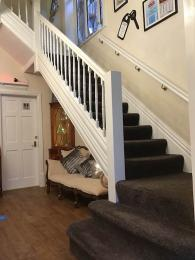 View of the stairs leading from the ground floor up to the first floor