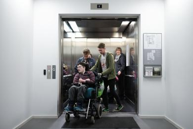 A photograph of the lift located next to the Garden reception in use.