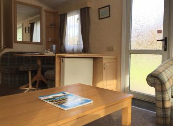 Standard 3 bedroomed caravan open plan Lounge access