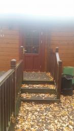3 steps up to Heron Lodge main entrance