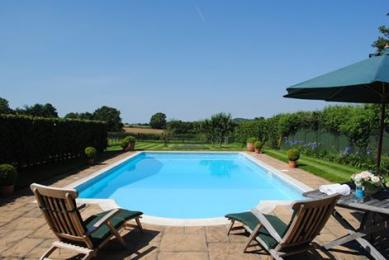 Private heated swimming pool for guests at The Stables (May-Aug)