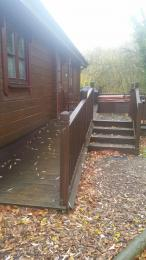 4 steps and ramp access up to Kingfisher Lodge main entrance