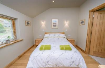 Double bedroom - bed can be moved to one side or turned round for more space .
