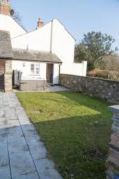 Garden area with hot tub, level paving allows access around garden and out into Orchard (grassy but reasonably level)
