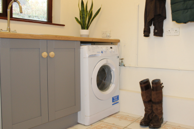 Laundry room with tumble dryer and washing machine