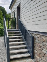 Staircase of nine steps to main entrance. Handrails on each side
