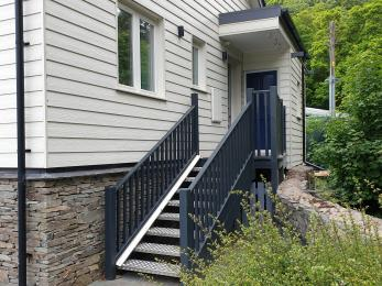 Staircase (9 steps) to rear door and cycle shed. Canoe store access under staircase