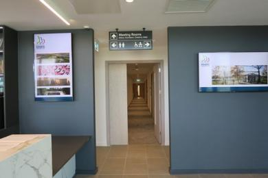 Access route to toilets and meeting rooms viewed from the Reception Desk