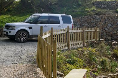 Own car parking area to side of cottage