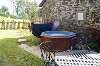 Private gated patio with hot tub