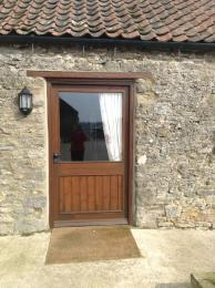 Annexe 4 entrance 114 cm concrete ramp opposite door or 3 steps with a handrail.
