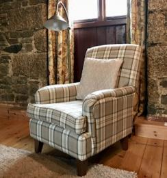 Armchair within the lounge at Mill Barn
