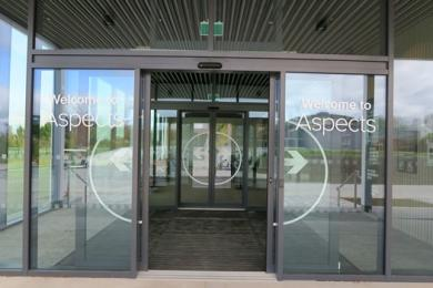 Aspects Building entrance lobby with 2 sets of auutomatic sliding doors