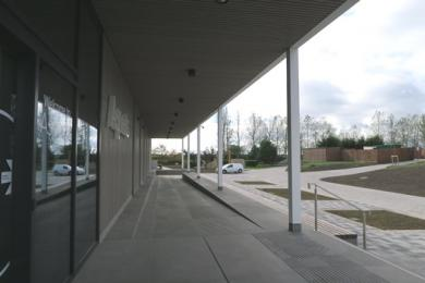 Ramp access to Aspects Building viewed from the front doors