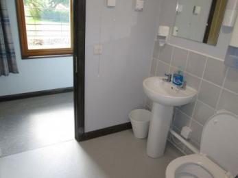 Bathroom two with door opening into hallway