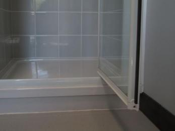 Bathroom two showing 200mm step into shower cubicle