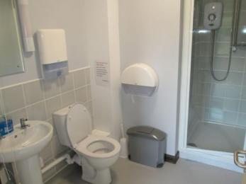 Bathroom two with basin, toilet and step-in shower