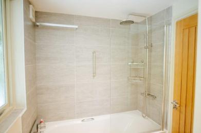 Bath and shower with handrail