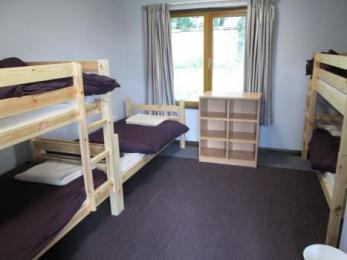 Bedroom two with two sets of bunk beds and one single bed