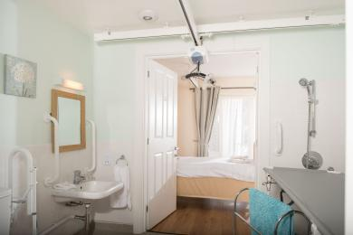 Ensuite wet room with ceiling tracking and hoist to shower table and toilet