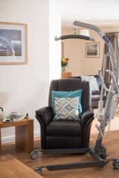 Rise Recliner in the lounge with mobile hoist