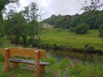 Bench over looking the River Derwent and Willersley Castle.
