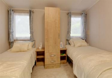 View of second twin bedroom with sliding door in the caravan holiday home at Blairgowrie Holiday Park