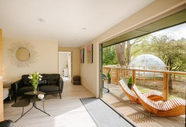 Open-plan lounge with French windows to decking area