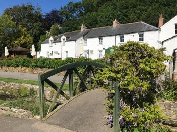 The bridge which requires crossing if you approach the cottages through the gardens.