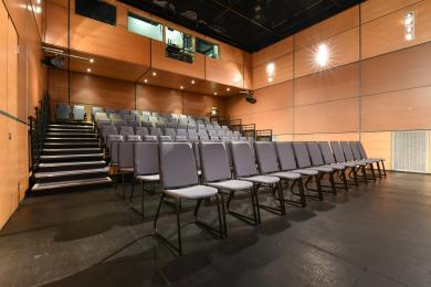 CCA Theatre. Blue seating bank with fixed and removable seats.